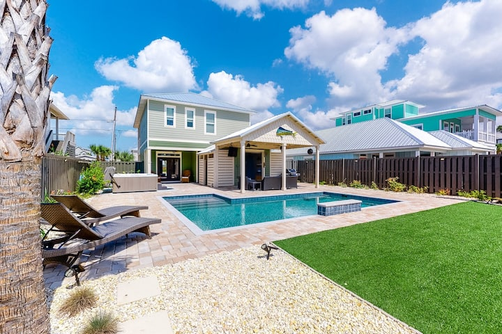 Perfect family home w/private pool, partial water view, and easy beach access!