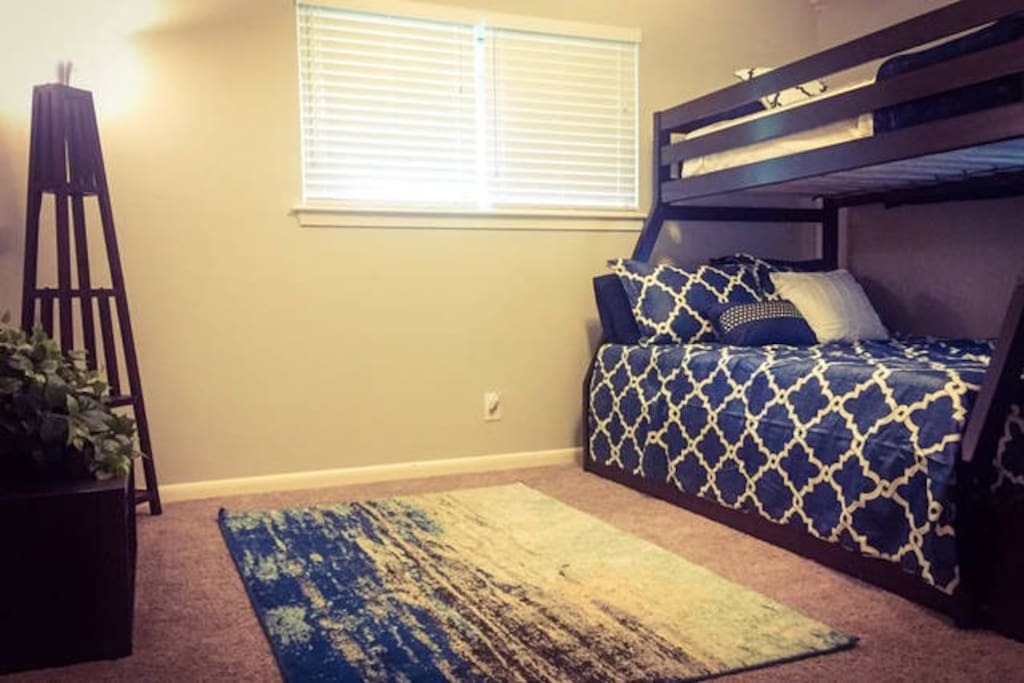Twin bunk on top with memory foam topper, full on bottom with memory foam topper and additional twin trundle under bed!  Storage space in large closet. :)