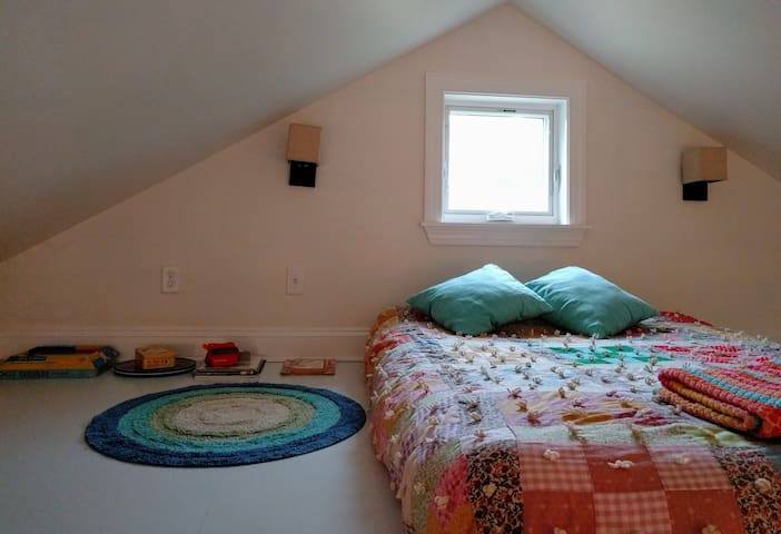 Sleeping loft with a full-size futon