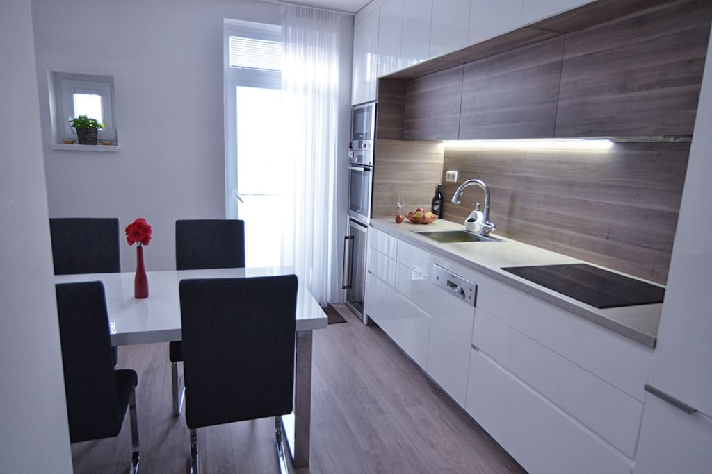 Modern kitchen with full equipment with fine table eating