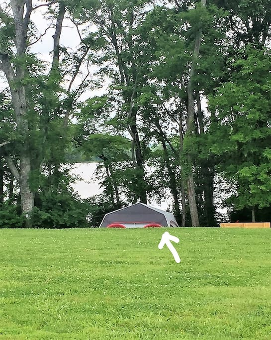 Arrow pointing at tent as you walk closer