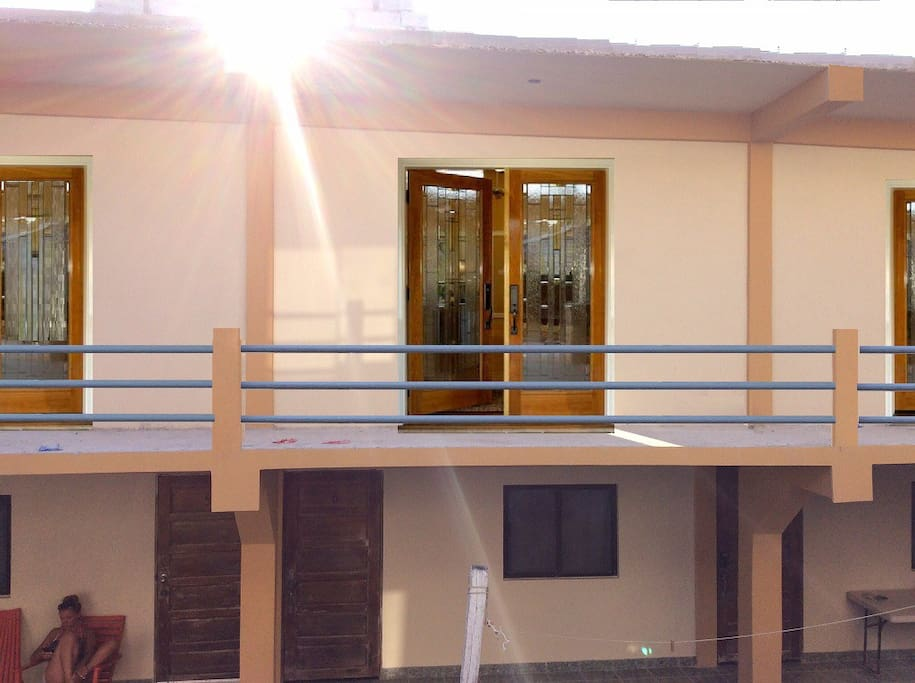 New Quad has balcony w limited side angle views of sea, budget quads are on ground floor