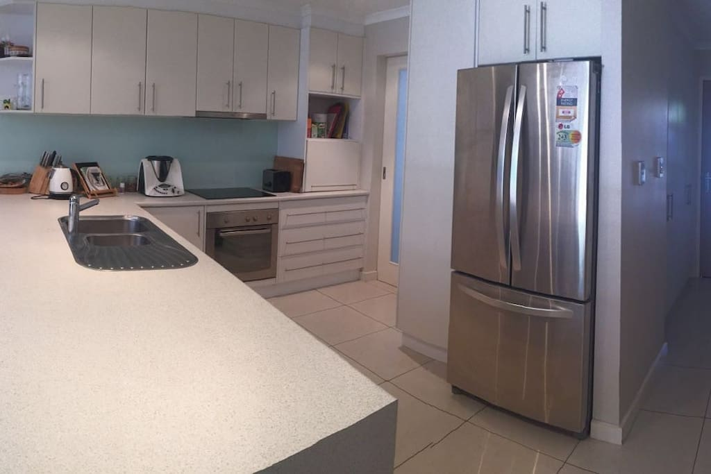 Full kitchen with twin drawer dish washers.