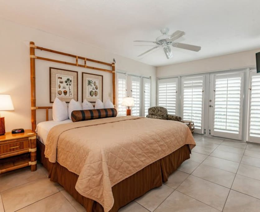 Mater bedroom has double French doors to balcony with water view.