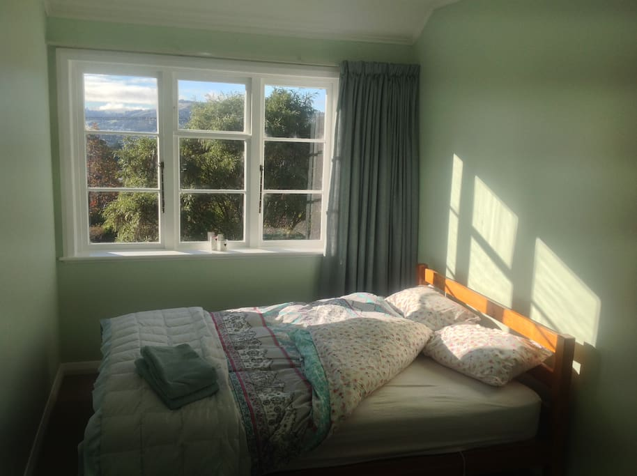 One sunny double bedroom.