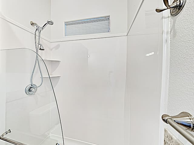 The en-suite master bathroom comes with a walk-in shower with a dual-head.