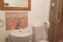 Shower, sink toilet in bathroom