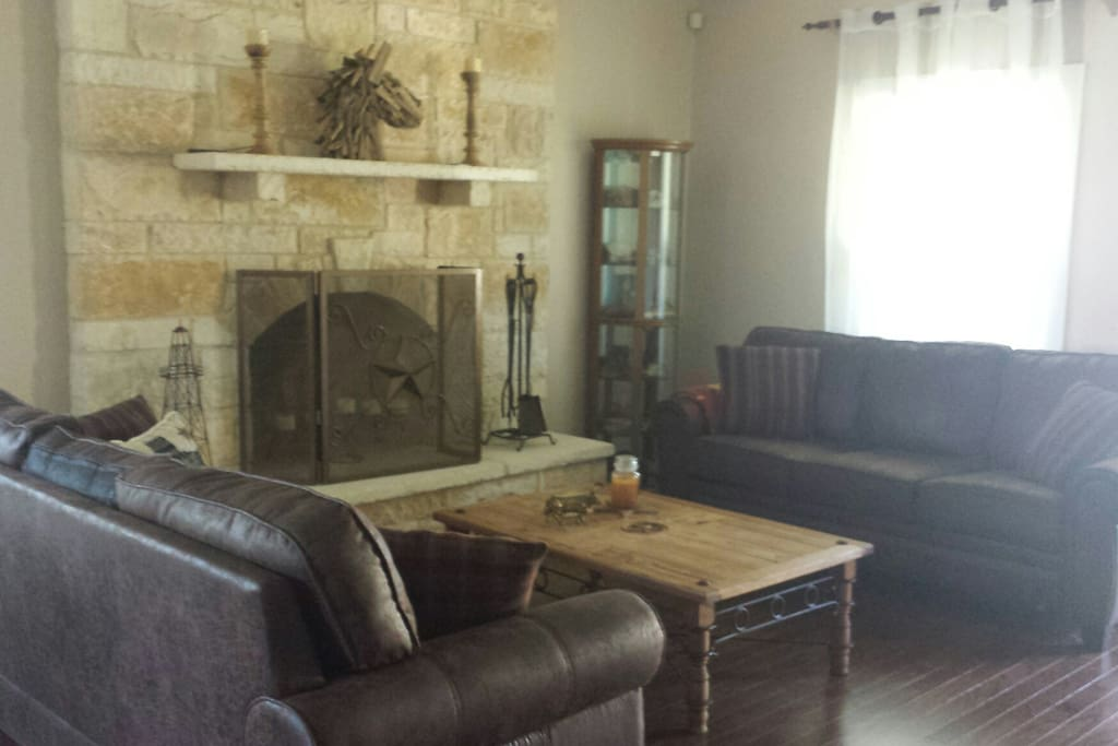 Large sitting area in front of stone fireplace