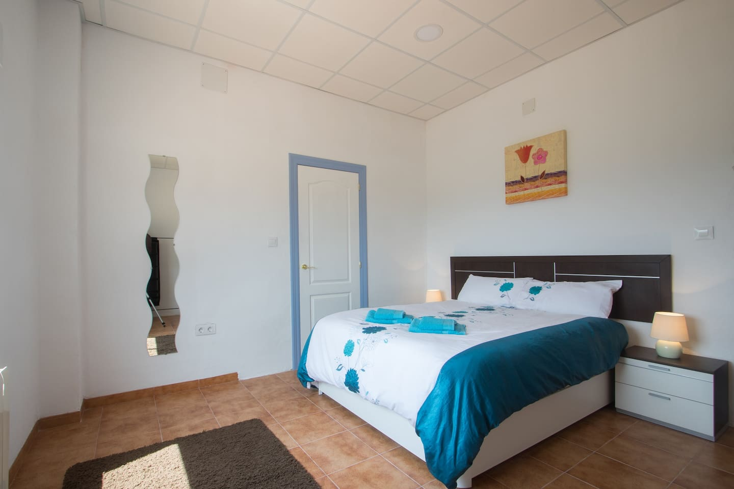 The spacious and bright room with its private, ensuite bathroom and a comfy king size bed