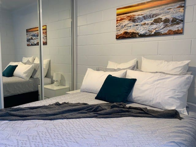 This cosy bedroom has all that you need including a pillow menu and built in wardrobe.