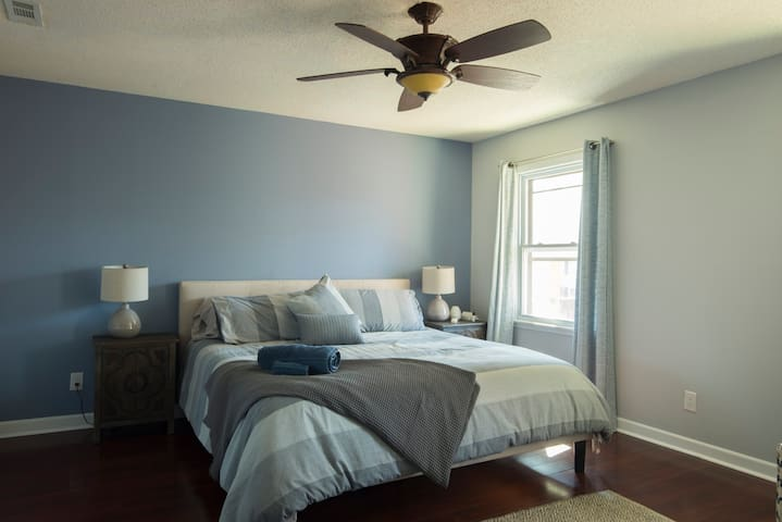The master bedroom boasts a comfortable king sized bed.