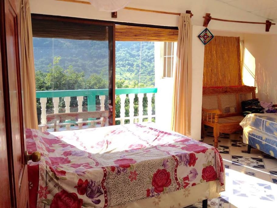 Large bedroom with view of Tamanique mountains.