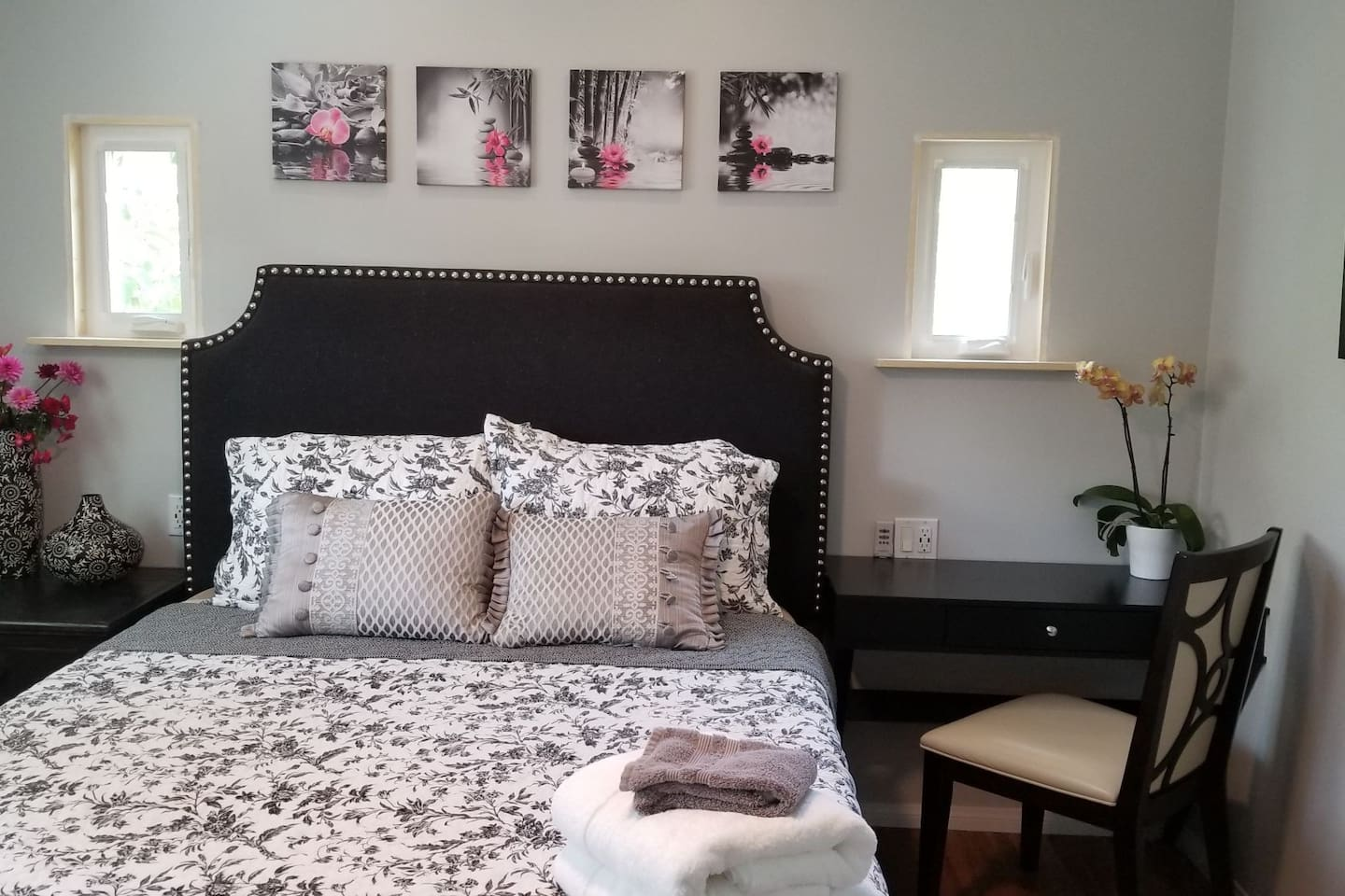 Modern bedroom with adjustable Queen bed, charging stations and writing desk.