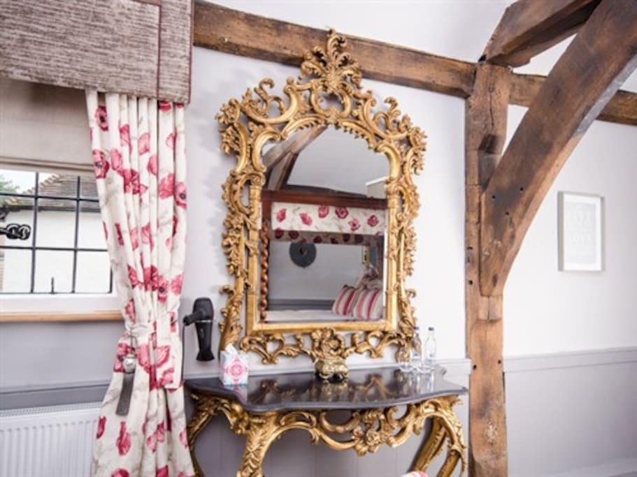 Get ready at the beautiful antique dressing table.