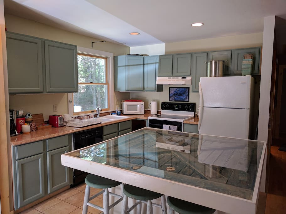 Kitchen, equipped with range/stove, microwave, dishwasher, lobster pot, and coffee maker.