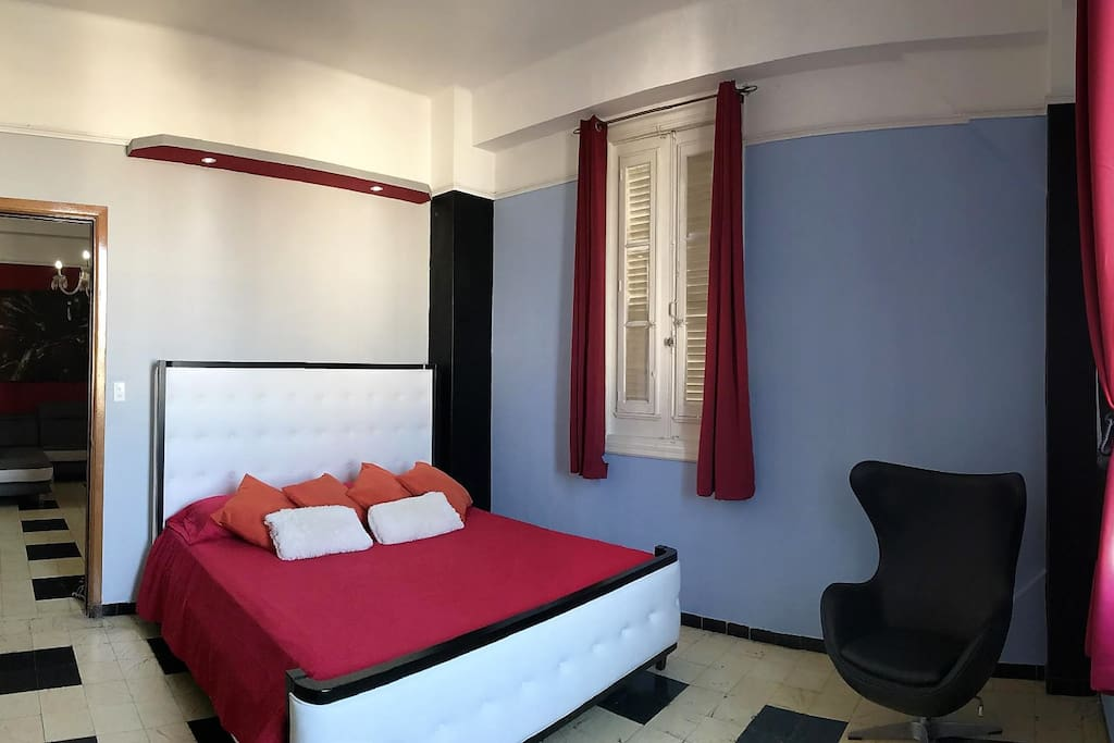 Bedroom with king size bed and comfortable mattress, from the windows an spectacular view of the city and the sea.