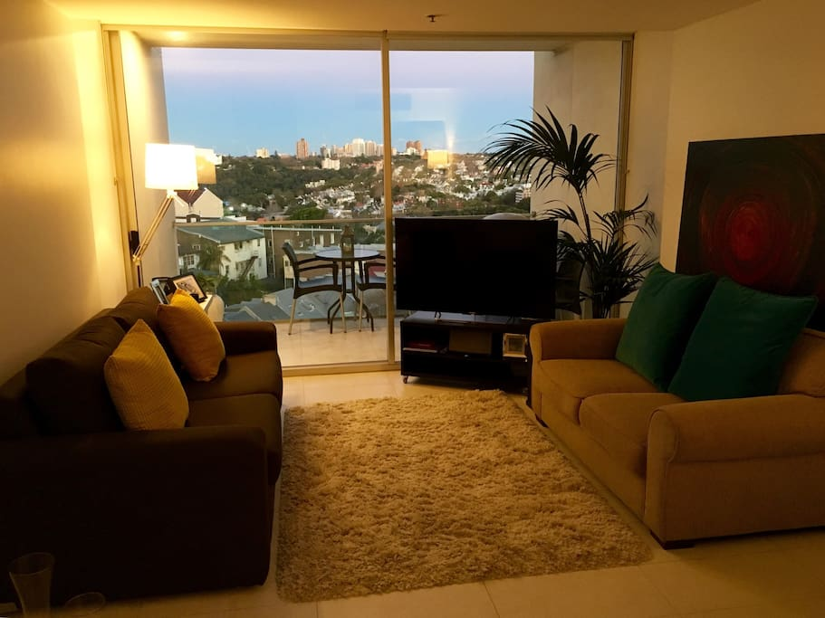 """Lounge with comfortable Queen size sofa bed, 50"""" TV, 2 seater sofa and big balcony."""
