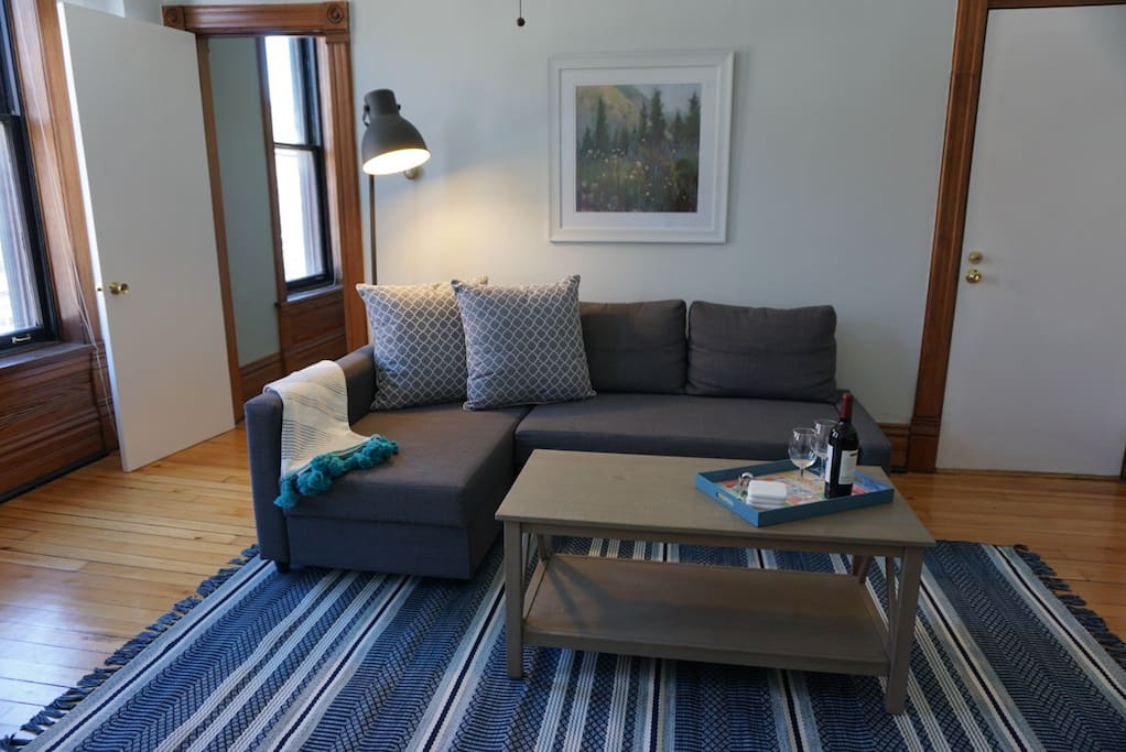 This living room is the perfect spot to hang out or curl up and watch your favorite Netflix shows on our smartTV
