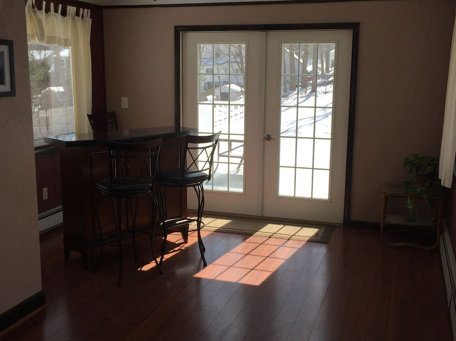 Bar in sun room with French doors that open to a 16x16 deck and large fenced-in yard