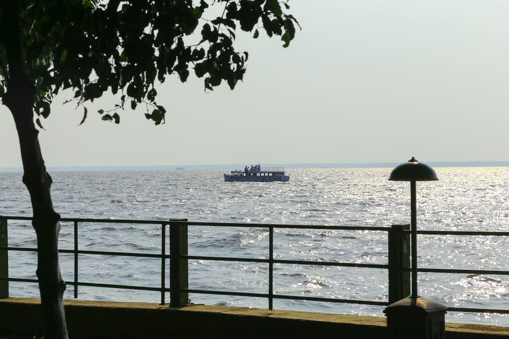View of the House Boat passing through the Great Vembanadu Lake from the property.