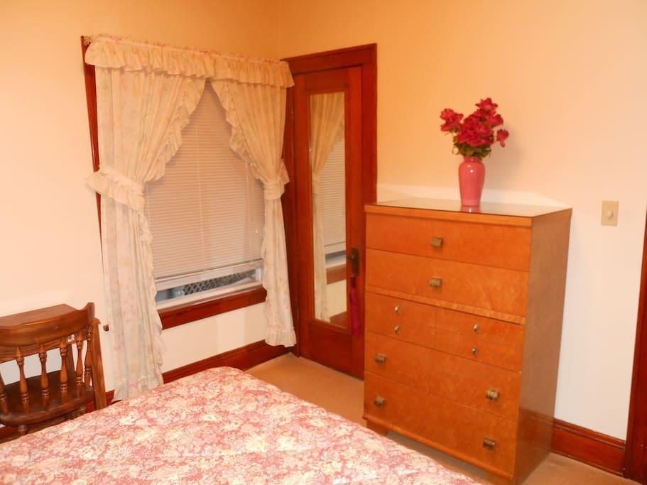 large window, closet space with hangers, full length mirror, plenty of storage