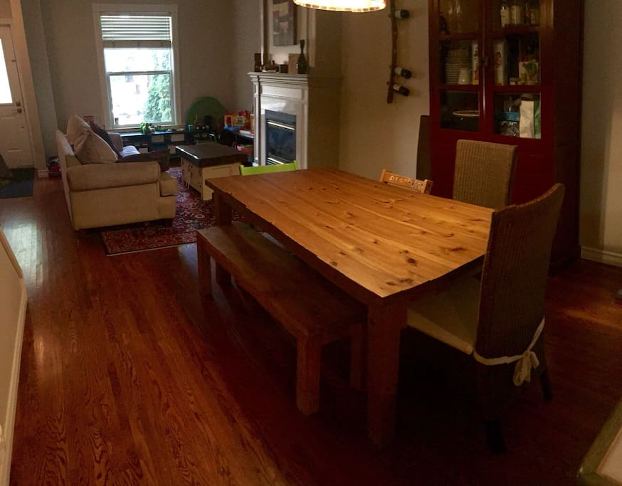 Dining room pictured with two high chairs that can be replaced with two standard chairs.