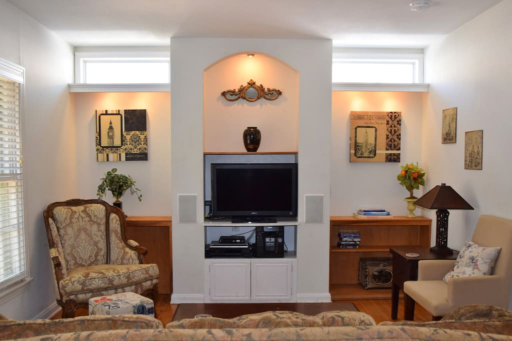 Family Room Features One of Three Flat Screen TVs- The House Also Features WIFI, Cable TV With DVR Service, CD Player, Roku