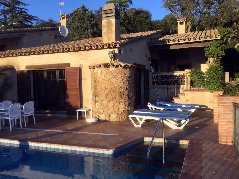 View of the villa by the pool in the late afternoon