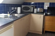 Kitchenette with microwave & fridge