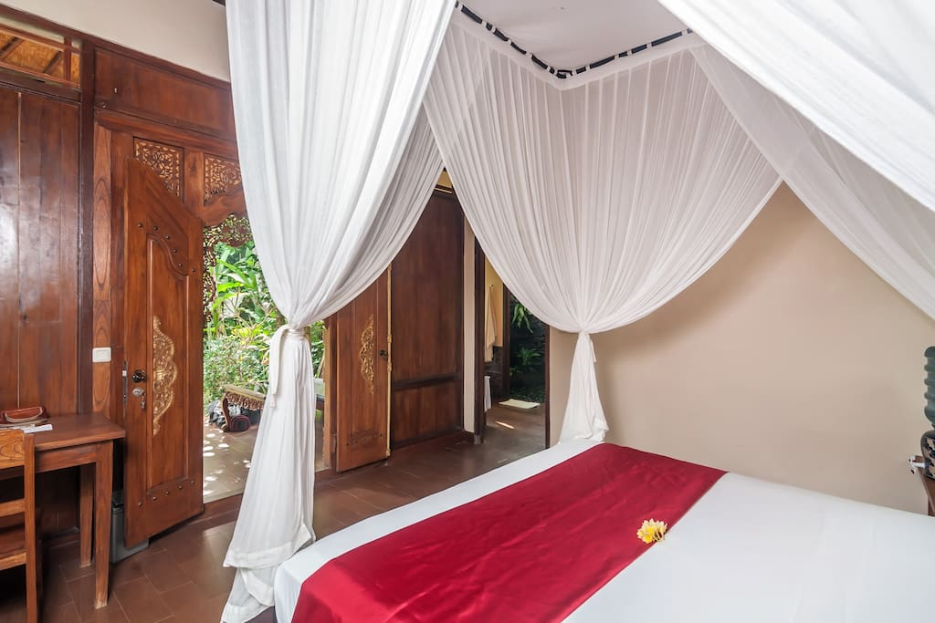 Looking out into the lush tropical garden from your bed.