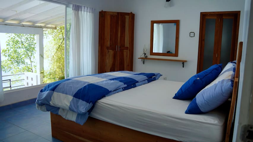 Bedroom with a laxapana waterfall view,has private bathroom
