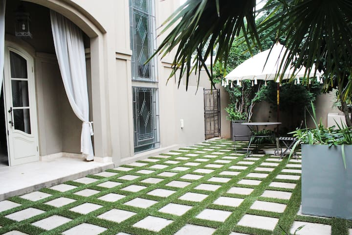 Private Courtyard with Table and Chairs