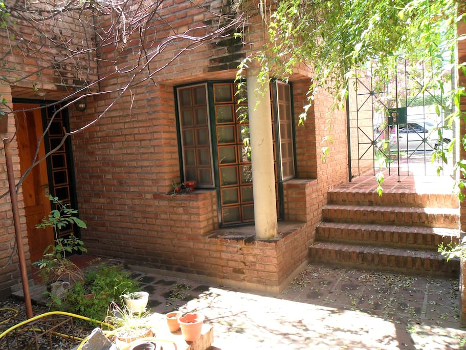 This is the entrance from the street, this is a shared patio with the main house.