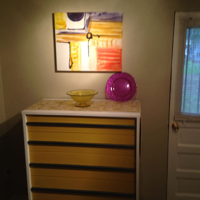 Tall coordinating dresser in the bedroom.
