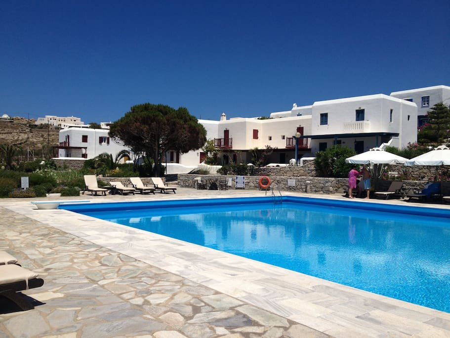 Large clean pool with bar on one side, 150 meters away from the house, within  he Costa Ilios resort, where the house is situated.