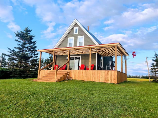 Ocean-front cottage on private, treed lot.