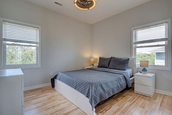 Bedroom with queen bed, private bathroom and TV