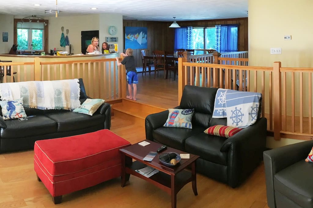 Large open living room leads to deck.