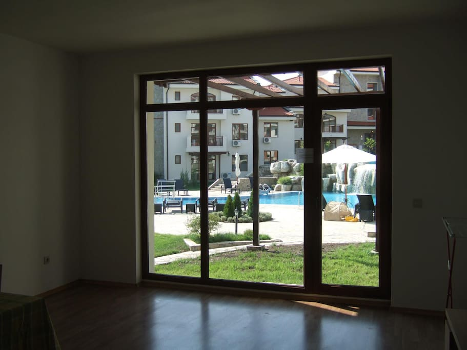 the living area which has 2 sofa beds and the small garden and access to the communal area and pool