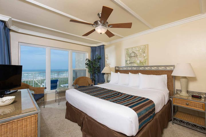 The master bedroom has a king-size bed and an amazing view!