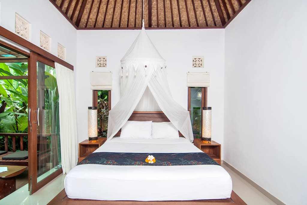 King sized bed with mosquito net