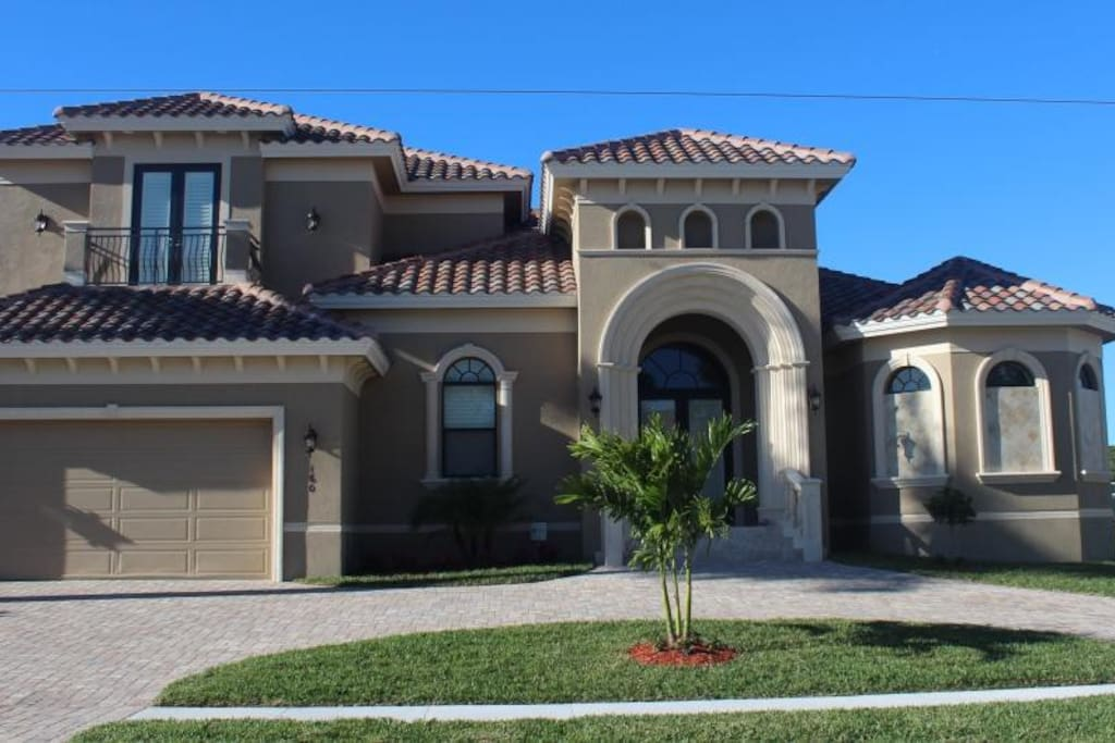 Welcome to Marco Getaway - Front exterior of home with keystone accents.