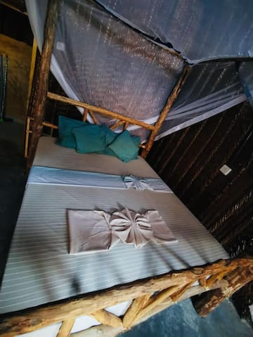 The Kingsize Bed for two People with a Mosquito Net for your Protection.