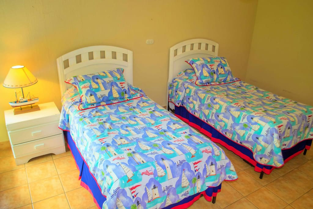 The cheerful hillside bedroom offers two twin beds that can be converted to a king.