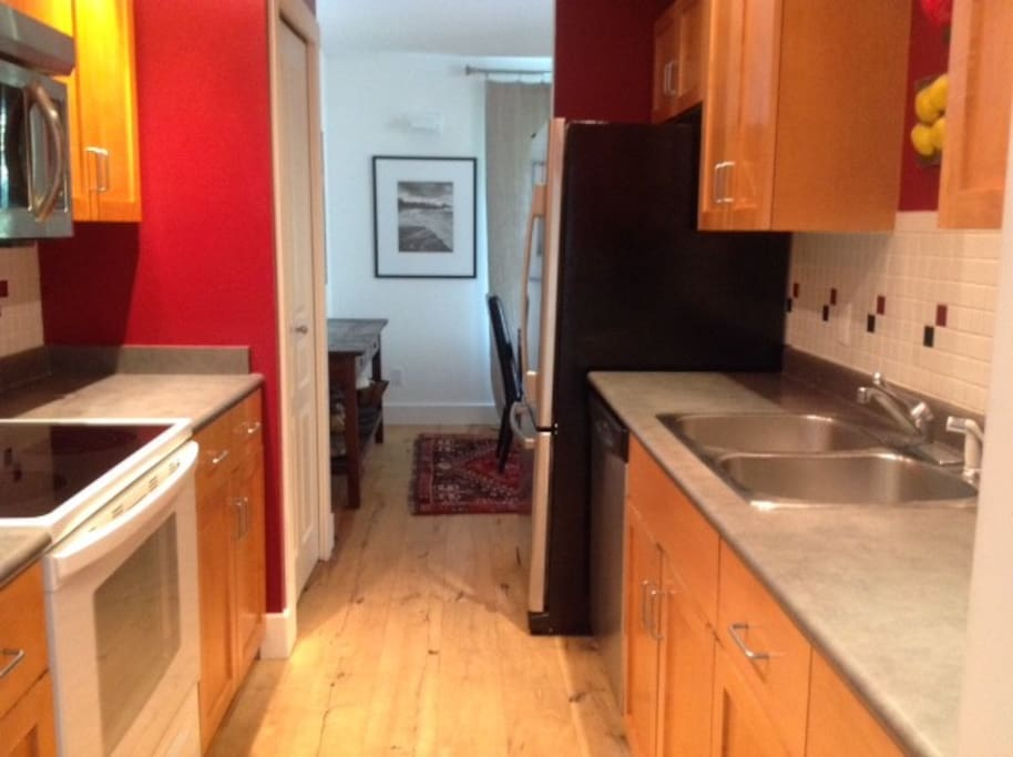 Kitchen with dishwasher and ensuite laundry
