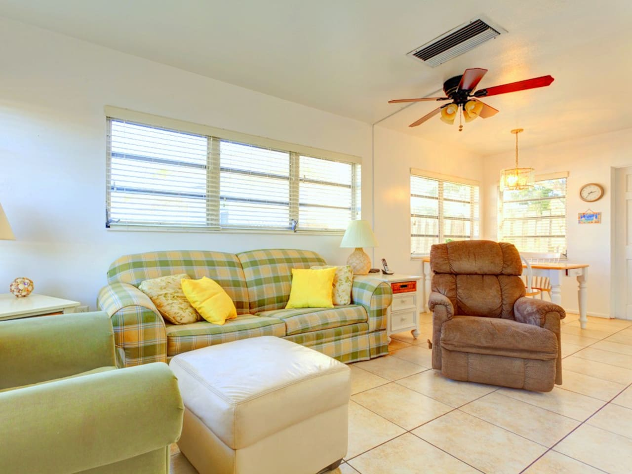 Relax in our classically laid-back Florida living room. Everything about our condo makes you want to relax and take it easy! From the cool tile floors to the ceiling fan, from the chic furnishings to the bright & sunny windows, you can enjoy it all and le