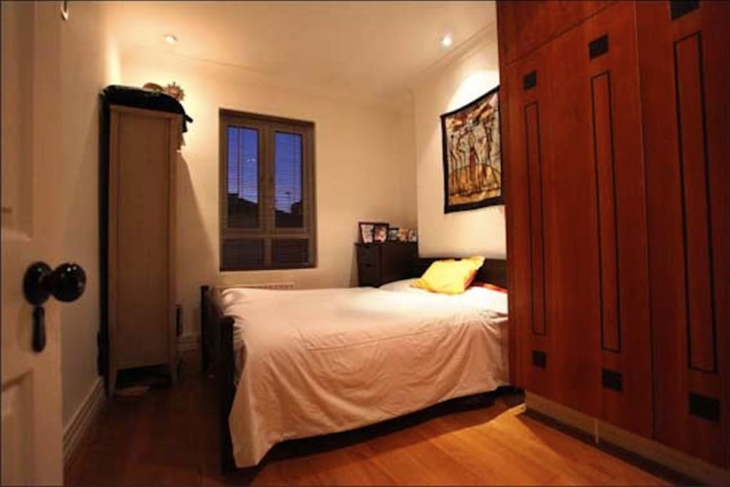 Large, bright double bedroom with wardrobe and storage. Wooden floor. Bedsheets and towels included.