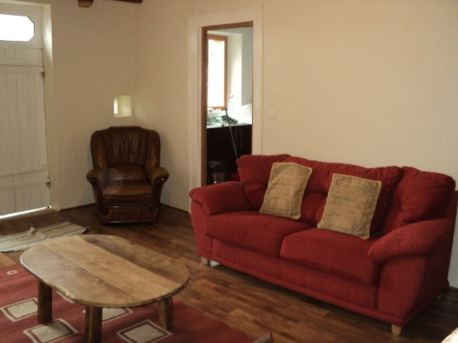 Comfortable living area with sat tv, dvd, woodburning stove.