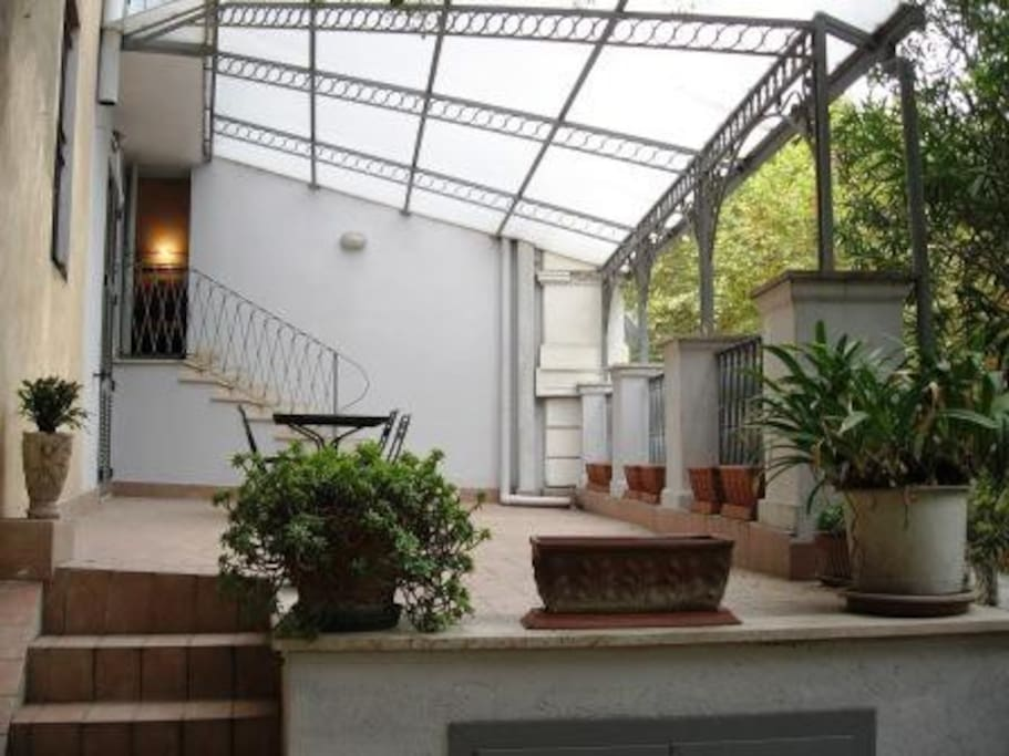 Covered terrace with lower level private garden