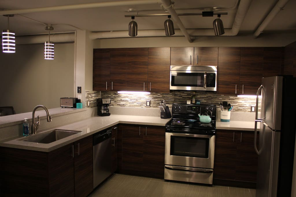 Fully Equipped Kitchen w/ Stainless Steel Appliances and Quartz Countertops